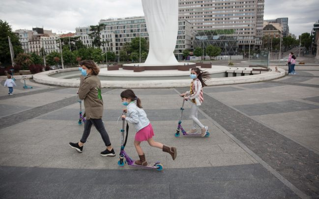 MADRID, SPAIN - APRIL 26. Mother walking with her daughters on April 26, 2020,​ at Plaza de Colón in Madrid, Spain. Children in Spain, which has had one of the stricter lockdowns in Europe, are now allowed to leave their homes for up to an hour per day. The country has had more than 220,000 confirmed cases of COVID-19 and over 20,000 reported deaths, although the rate has declined after weeks of quarantine measures. (Photo by Miguel Pereira/Getty Images).