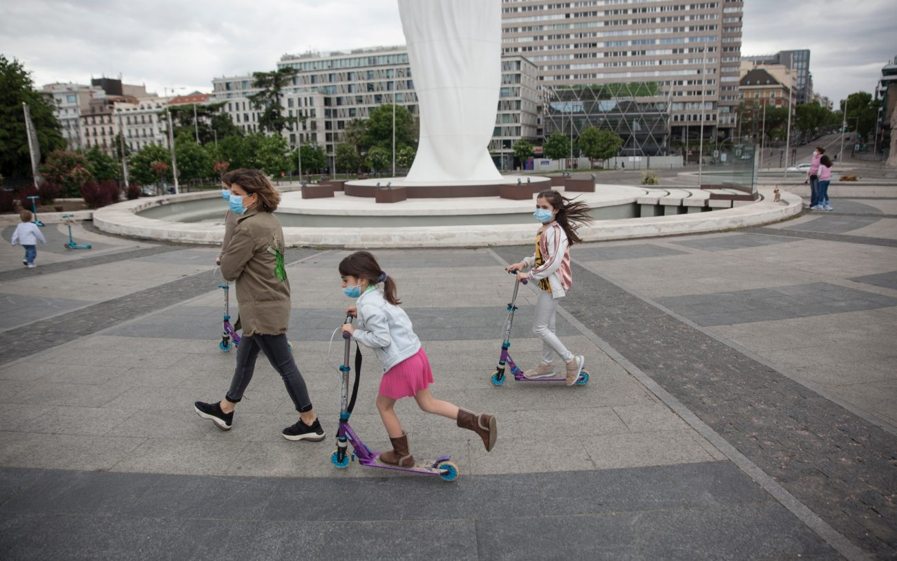 MADRID, SPAIN - APRIL 26. Mother walking with her daughters on April 26, 2020, at Plaza de Colón in Madrid, Spain. Children in Spain, which has had one of the stricter lockdowns in Europe, are now allowed to leave their homes for up to an hour per day. The country has had more than 220,000 confirmed cases of COVID-19 and over 20,000 reported deaths, although the rate has declined after weeks of quarantine measures. (Photo by Miguel Pereira/Getty Images).