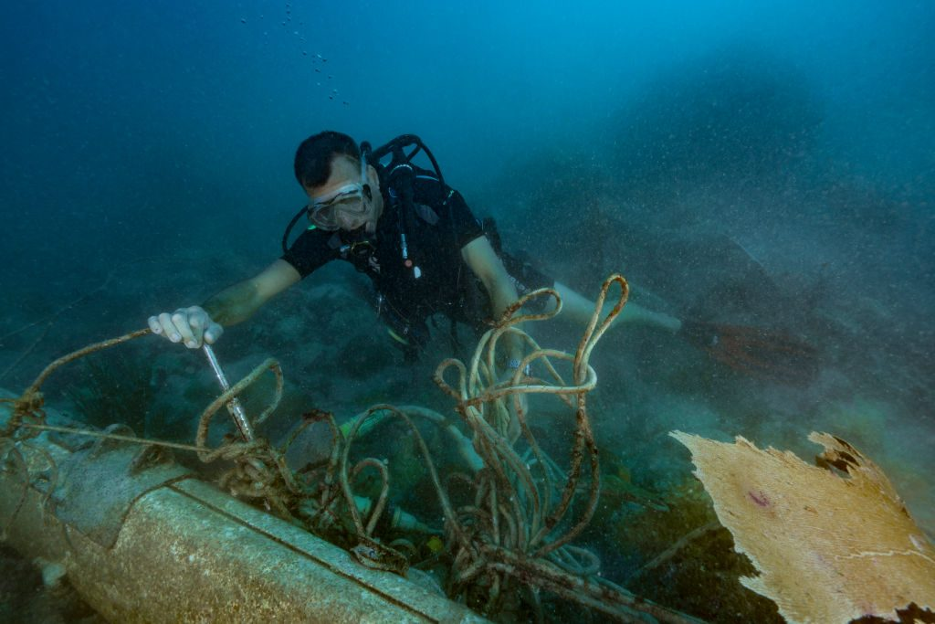 SAINT-MARTIN, FRENCH ANTILLES - NOVEMBER 2017: Franck Roncuzzi, a member of the French Agency for Biodiversity and head of environmental police who works at the Marine Natural Park of St. Martin is diving to take a stock few weeks after hurricane Irma on November 14, 2017, Saint-Martin, French Antilles. During his dive, he noticed a lot of debris from boats or other objects from the island. (Photo by Alexis Rosenfeld/Getty Images)