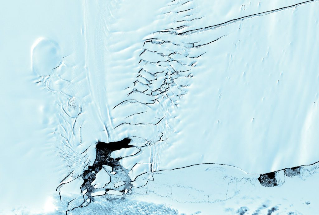 This image taken 12 December 2000 and released by NASA 22 March 2001 shows a crack (Upper L) on Pine Island glacier is also seen by the ASTER instrument, on board the TERRA satellite. At its widest point, the crack is 400-500 meters across. Scientists believe that the crack appeared rapidly, less than five weeks, and would begin calving icebergs in approximately 18 months. On the left hand side of the image, stress fractures in the ice are clearly seen. AFP PHOTO (Photo by - / NASA / AFP) (Photo by -/NASA/AFP via Getty Images)