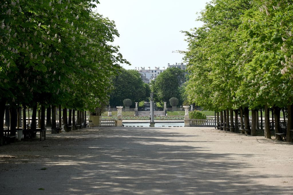 A picture taken on April 20, 2020 shows an empty alley of the closed Jardin du Luxembourg park in Paris on the 35th day of a strict lockdown in France aimed at curbing the spread of the COVID-19 infection caused by the novel coronavirus. (Photo by ERIC PIERMONT / AFP) (Photo by ERIC PIERMONT/AFP via Getty Images)